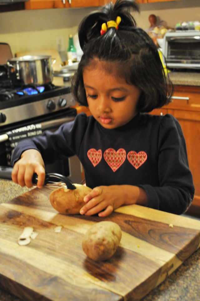 Kids Thanksgiving Peeling Potatoes