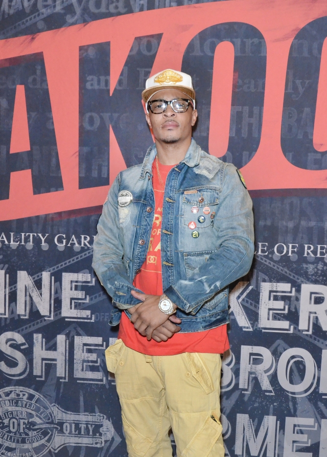 T.I. entering the Akoo 5 Year Anniversary Party